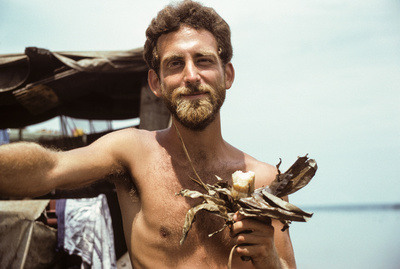 Travel Photographer Eric A. Wessman with manioc on a cargo boat on the Zaire (Congo) River.