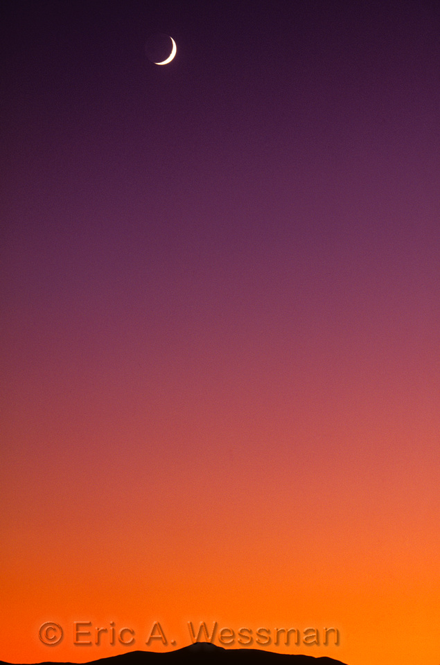 Crescent moon over graduated sunset sky, Maxwell National Wildlife Refuge, New Mexico, USA.
