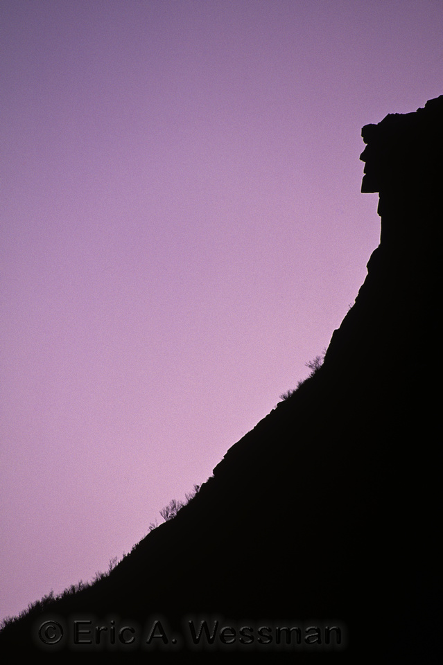 Silhouette of Old Man of the Mountain at dusk. Franconia Notch, New Hampshire.