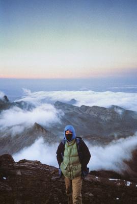 Photographer Eric A. Wessman on the summit of Point Lenana, Mount Kenya.