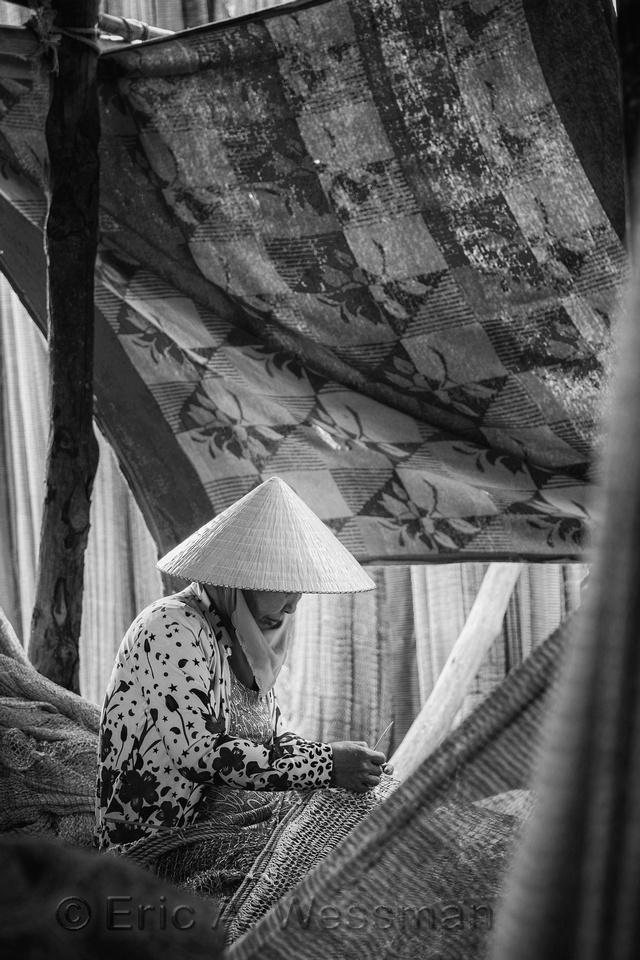 Woman Mending Net